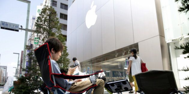 TOKYO, JAPAN - SEPTEMBER 12: (CHINA OUT, SOUTH KOREA OUT) People make a queue for buying the new iPhone...