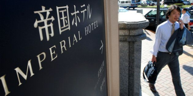 JAPAN - SEPTEMBER 21: A man walks past a sign outside the Imperial Hotel in Tokyo, Japan, on Friday,...