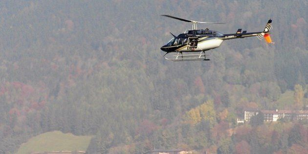 TEGERNSEE, GERMANY - OCTOBER 11: A helicopter with a film camera crew circles above lake Tegernsee after...