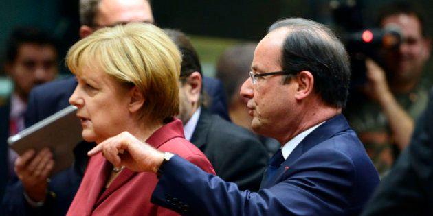 French President Francois Hollande (R) talks on October 24, 2013 with German Chancellor Angela Merkel...
