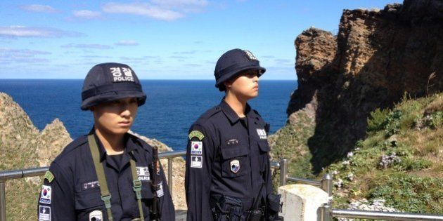 DOKDO ISLAND, SOUTH KOREA - OCTOBER 4: South Korean national police guard the islands in pairs positioned...