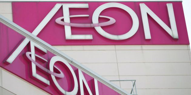 Aeon Co. logos are displayed atop the company's shopping center in Tokyo, Japan, on Thursday, April 12,...