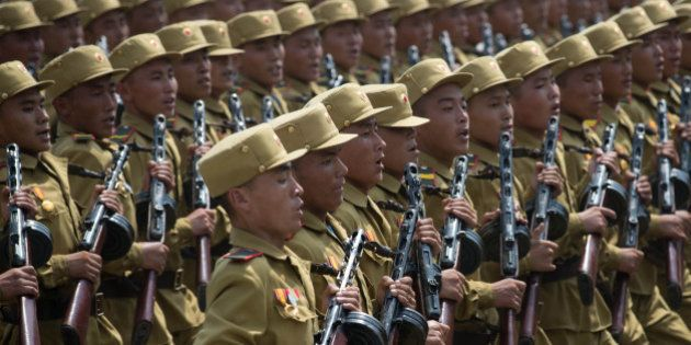 In a photo taken on July 27, 2013 North Korean soldiers march through Kim Il-Sung square during a military...
