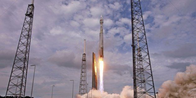 An AtlasV rocket, carrying the Maven spacecraft, blasts off at Cape Canaveral Air Force Station, Fla.,...