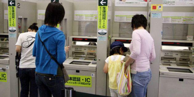 JAPAN - MAY 21: Customers use a Sumitomo Mitsui Bank's ATM in Tokyo, Japan, on Monday, May 21, 2007....
