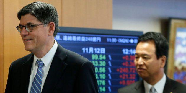 Jacob 'Jack' Lew, U.S. treasury secretary, left, and Akira Amari, Japan's minister of state for economic...