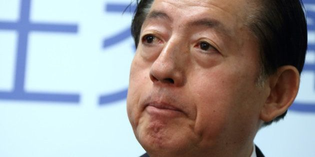 Akihiro Ohta, Japan's minister of land, infrastructure, transport and tourism, listens during a news...