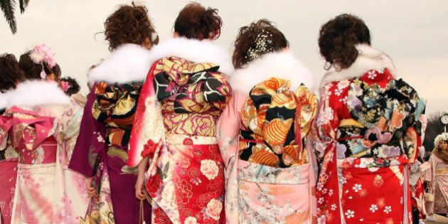 TOKYO - JANUARY 11: Japanese twenty-year-old women, dressed in traditional kimonos, attend the annual...