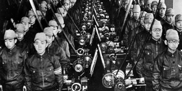JAPAN - 1939: War 1939-1945. Japanese students mobilized to work in a factory. LAPI-45399A. (Photo by...