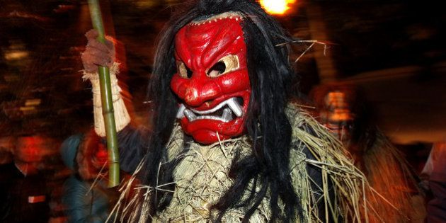 OGA, JAPAN - FEBRUARY 13: A man dressed in straw clothes and an orge mask as Namahage, or a mountain...