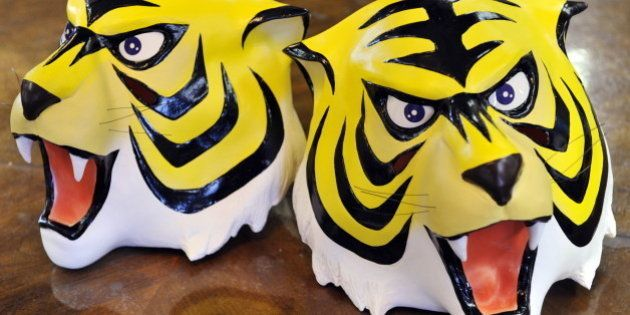 Rubber masks of cartoon character 'Tiger Mask' a masked professional wrestling manga hero is displayed...