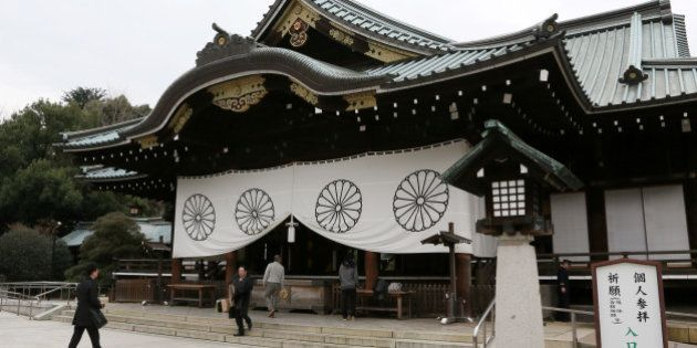 People visit the Yasukuni Shrine in Tokyo, Japan, on Thursday, Dec. 26, 2013. Shinzo Abe became the first...