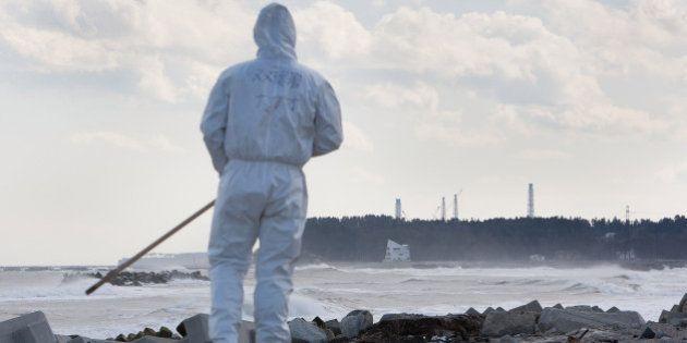 NAMIE, FUKUSHIMA PREFECTURE - FEBRUARY 27: Police search Ukedo beach, within sight of the crippled Fukushima...