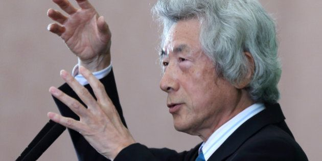 Junichiro Koizumi, former Japan prime minister, gestures as he speaks during a news conference at the...