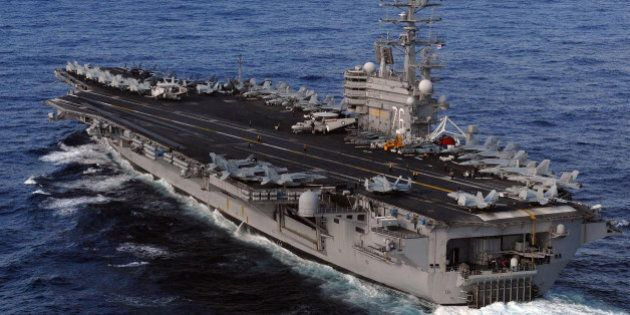 PACIFIC OCEAN - MARCH 12: In this handout provided by the U.S. Navy, the Nimitz-class aircraft carrier...