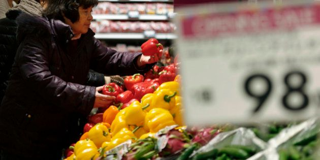 A customer browses capsicums at the Aeon Style Store in the Aeon Mall Makuhari Shintoshin shopping mall,...