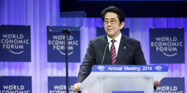 Shinzo Abe, Japan's prime minister, speaks during a session on the opening day of the World Economic...