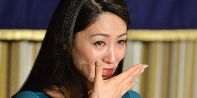 Miss International 2012, Ikumi Yoshimatsu of Japan, reacts as she speaks during a press conference at...
