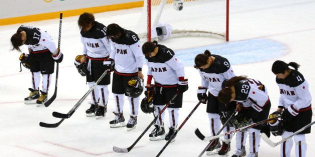 SOCHI, RUSSIA - FEBRUARY 11: Team Japan looks on after being defeated 2 to 1 by Team Russia after their...