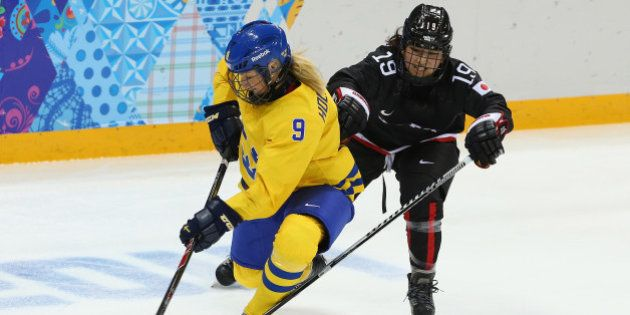 SOCHI, RUSSIA - FEBRUARY 09: Josefine Holmgren #9 of Sweden is challenged by Miho Shishiuchi #19 of Japan...
