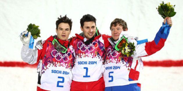 SOCHI, RUSSIA - FEBRUARY 10: (L-R) Silver medalist Mikael Kingsbury of Canada, gold medalist Alex Bilodeau...