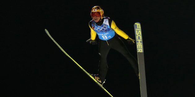 SOCHI, RUSSIA - FEBRUARY 17: Noriaki Kasai of Japan jumps during the Ski Jumping Men's Team Large Hill...
