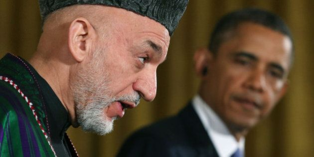 WASHINGTON, DC - JANUARY 11: U.S. President Barack Obama (R) and Afghan President Hamid Karzai speak...