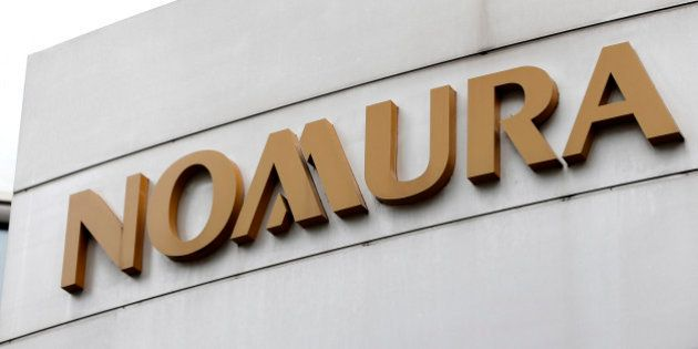 Signage for Nomura Securities Co. is displayed outside one of its branches in Tokyo, Japan, on Sunday,...