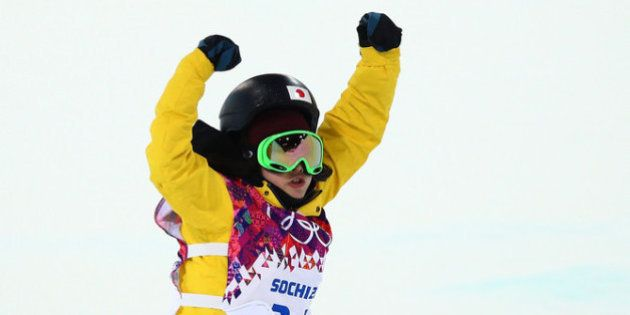 SOCHI, RUSSIA - FEBRUARY 12: Rana Okada of Japan celebrates after completing her run in the Snowboard...