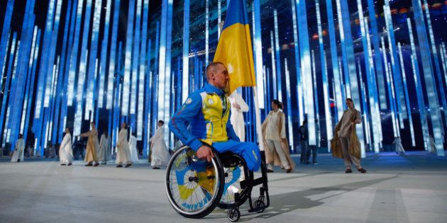 SOCHI, RUSSIA - MARCH 07: Flag bearer Mykailo Tkachenko of the Ukraine enters the arena during the Opening...