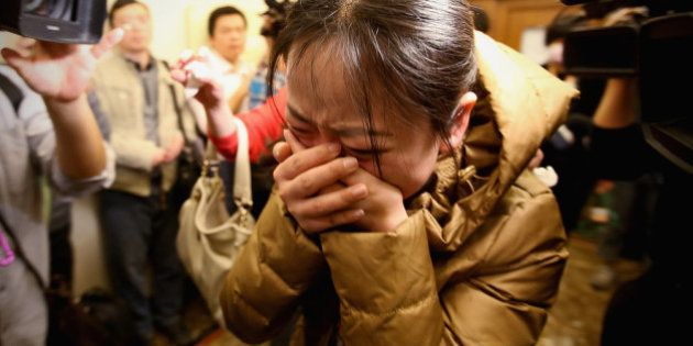 BEIJING, CHINA - MARCH 09: A relative of a passenger onboard Malaysia Airlines flight MH370 cries out...