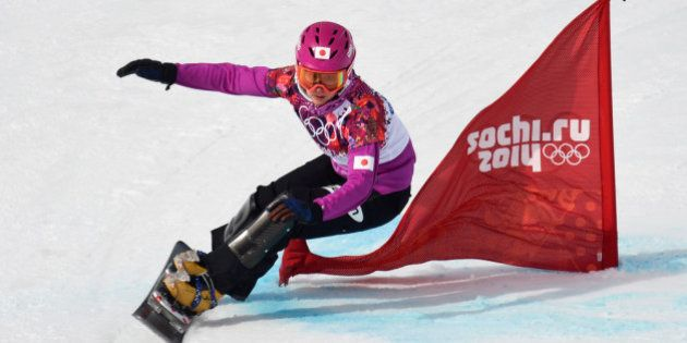 SOCHI, RUSSIA - FEBRUARY 19: Tomoka Takeuchi of Japan competes in the Snowboard Ladies' Parallel Giant...