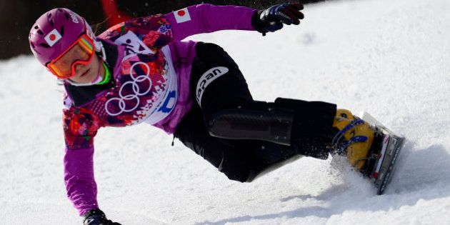 Japan's Tomoka Takeuchi competes in the Women's Snowboard Parallel Giant Slalom Semifinals at the Rosa...