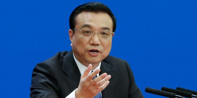 BEIJING, CHINA - MARCH 13: Chinese Premier Li Keqiang speaks during a news conference after the closing...
