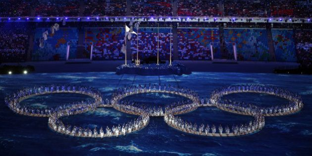 SOCHI, RUSSIA - FEBRUARY 23: Performers make the shape of the Olympic Rings during the 2014 Sochi Winter...