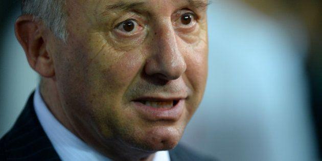 YOKOHAMA, JAPAN - SEPTEMBER 10: Japan head coach Alberto Zaccheroni looks on during the international...