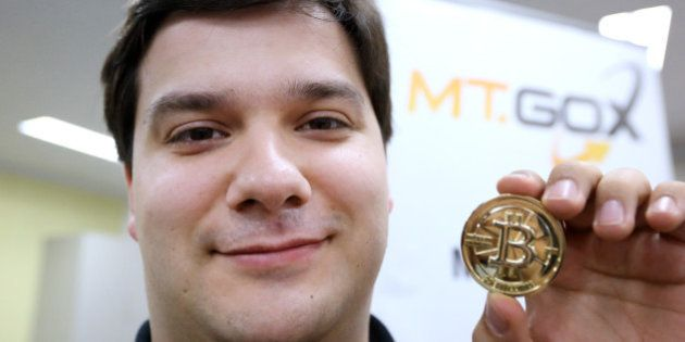Mark Karpeles, chief executive officer of Tibanne Co., poses for a photograph with a bitcoin in the office...