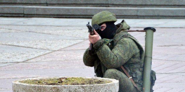 SIMFEROPOL, UKRAINE - MARCH 1: Unidentified gunmen wearing camouflage uniforms stand guard on the street...