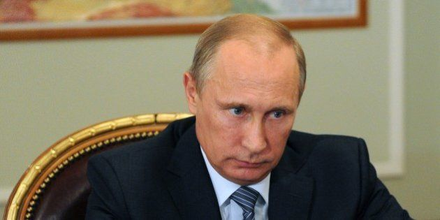 Russia's President Vladimir Putin attends a meeting in his Novo-Ogaryovo residence outside Moscow, on...