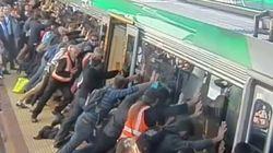 電車に挟まれた男性を乗客たちが力を合わせて救う:オーストラリア【動画】