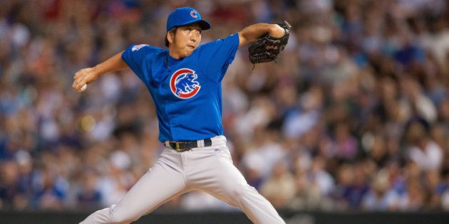 DENVER, CO - AUGUST 06: Kyuji Fujikawa #11 of the Chicago Cubs pitches in the sixth inning of a game...