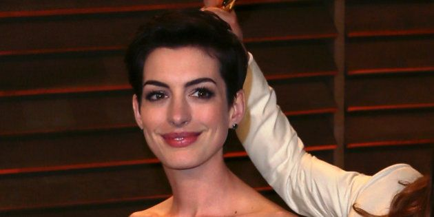 WEST HOLLYWOOD, CA - MARCH 02: Actor Jared Leto photobombs actress Anne Hathaway at the 2014 Vanity Fair...