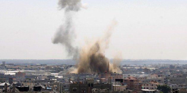 Smoke billows following an Israeli air strike in Rafah, in the southern Gaza Strip, on August 08, 2014....