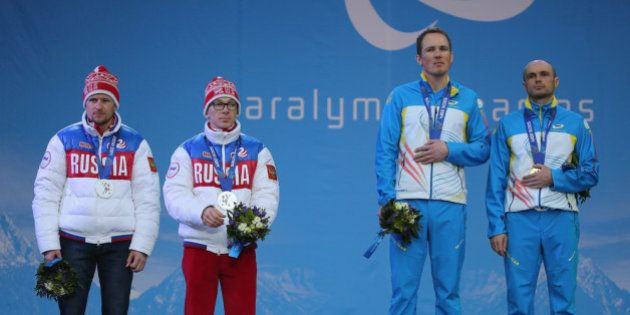 SOCHI, RUSSIA - MARCH 09: Vitaliy Lukyanenko of Ukraine with guide, Borys Babar win gold in the Men's...