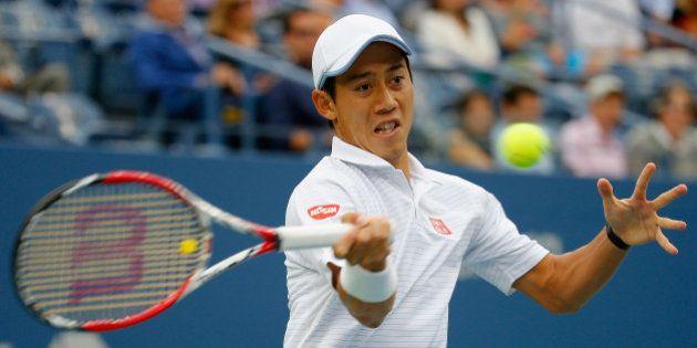 NEW YORK, NY - SEPTEMBER 08: Kei Nishikori of Japan returns a shot against Marin Cilic of Croatia during...