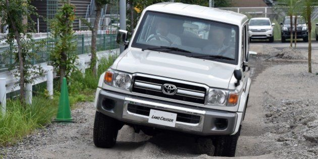 Customers test-drive Japan's auto giant Toyota Motor's 30th anniversary model of 'Land Cruiser 70', equipped...