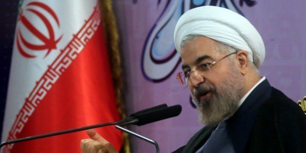 Iranian President Hassan Rouhani speaks during a press conference in the capital Tehran on June 14, 2014....
