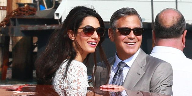 VENICE, ITALY - SEPTEMBER 28: Actor George Clooney and Amal Alamuddin sighted on Canal Grande on September...