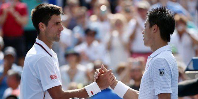 Kei Nishikori of Japan (R) shakes Novak Djokovic of Serbia (L) after Nishikori won during their 2014...