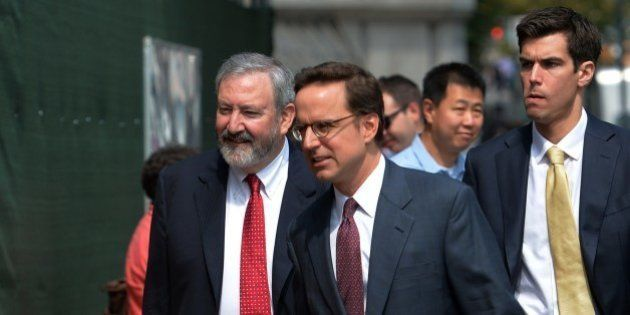 Attorneys Carmine Boccuzzi (C) and Jonathan Blackman (L) arrive at the US Federal Courthouse August 1,...